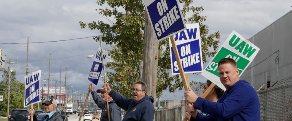 Charlie Illig, a 22-year GM employee, pickets along with co-workers outside the General Motors Fabrication Division, Friday, Oct. 4, 2019, in Parma, Ohio. (AP Photo/Tony Dejak)