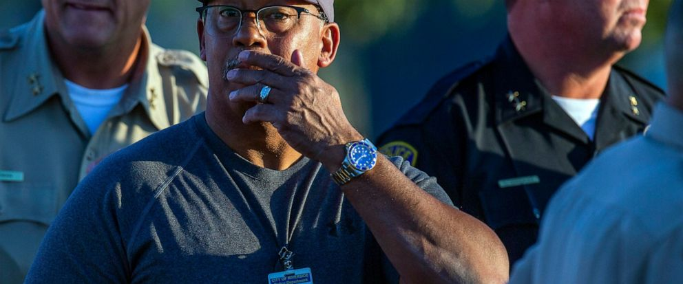 Riverside City Deputy Chief of Police Jeffrey Greer reacts at the scene where a shootout near a freeway killed a California Highway Patrol officer and wounded two others before the gunman was fatally shot, Monday, Aug. 12, 2019, in Riverside, Calif.