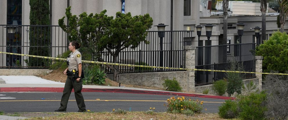 FILE - In this Sunday, April 28, 2019 file photo, a San Diego county sheriffs deputy stands in front of the Chabad of Poway synagogue, in Poway, Calif. A 19-year-old nursing student who opened fire at the California synagogue in April didnt have a