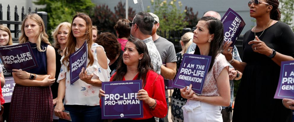 FILE - In this June 4, 2019, file photo, Anti-abortion advocates gather outside the Planned Parenthood clinic in St. Louis. Timing threatens to stymie efforts to let the public vote on a new Missouri law banning abortions at eight weeks of pregnancy