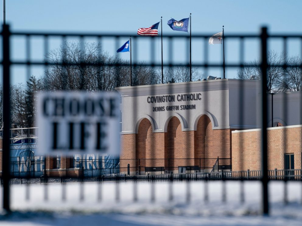 Flags fly over the Covington Catholic High School stadium in Park Kills, Ky., Sunday, Jan 20, 2019. A diocese in Kentucky has apologized after videos emerged showing students from the Catholic boys high school mocking Native Americans outside the Li