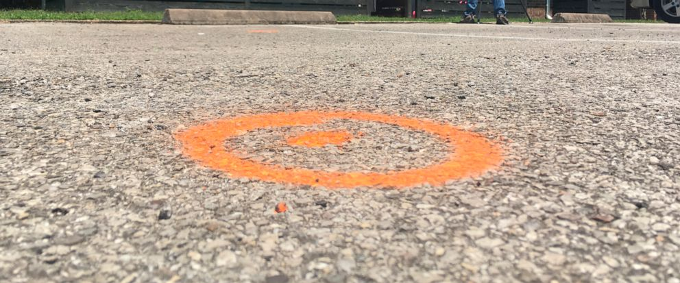 Spray paint marks the spot at a Houston-area apartment complex in Baytown, Texas, Tuesday, May 14 ,2019, where police say an officer shot and killed a woman after she hit him with his Taser during a struggle, shocking him. Police Lt. Steve Dorris sai