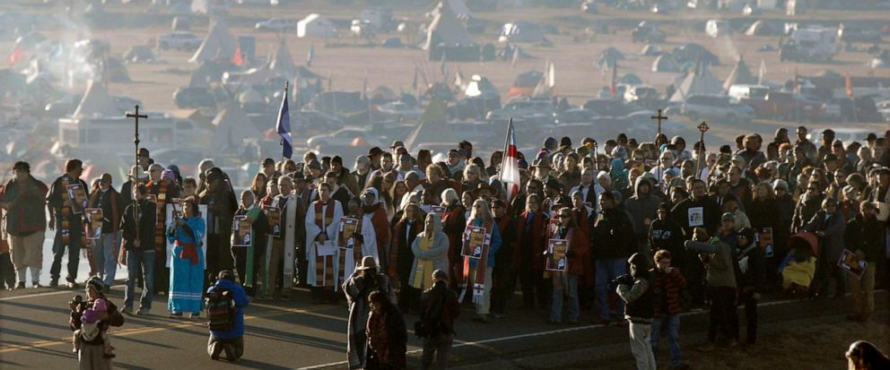 """FILE - In this Nov. 11, 2016, file photo, more than 500 clergy from across the country gather for a """"Clergy for Standing Rock"""" march on N.D. Highway 1806 near Cannon Ball, N. D. Attorneys for oil pipeline opponents are fighting an attempt by a South"""