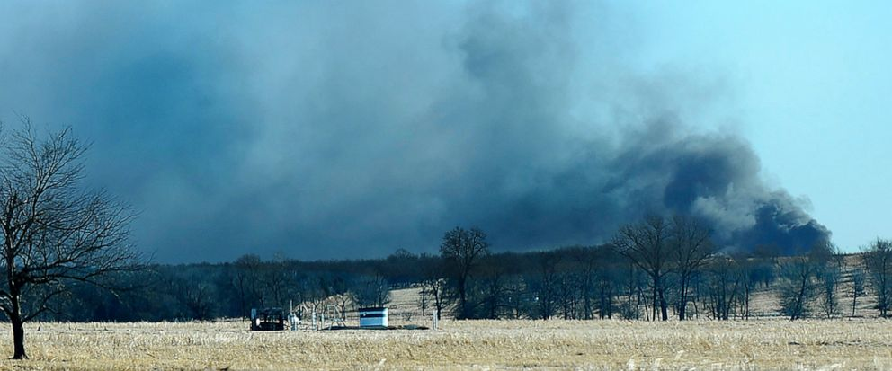 FILE - In this Monday, Jan. 22, 2018, file photo, smoke billows from the site of a gas well fire near Quinton, Okla. A federal report says the explosion and fire that killed five workers at the southeastern Oklahoma natural gas well in 2018 was cause