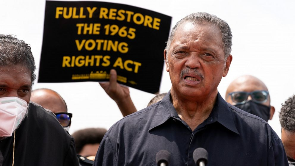 FILE - In this Monday, Aug. 2, 2021 file photo, Rev. Jesse Jackson speaks to the crowd during a demonstration supporting the voting rights, on Capitol Hill, in Washington. The Rev. Jesse Jackson and his wife, Jacqueline, have been hospitalized after