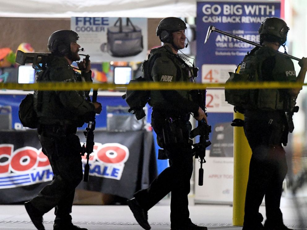 Heavily armed police officers exit the Costco following a shooting inside the wholesale warehouse in Corona, Calif., Friday, June 14, 2019. A gunman opened fire inside the store during an argument, killing a man, wounding two other people and sparkin