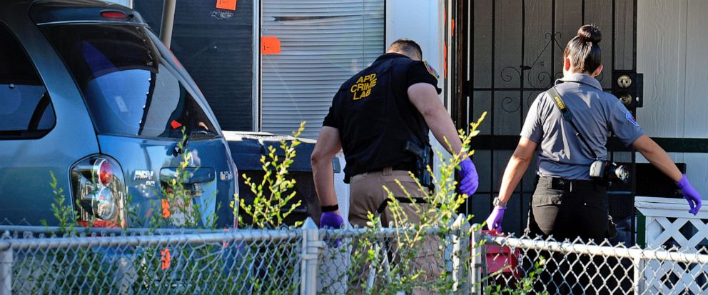 Albuquerque Police Crime Lab personnel work at the scene Friday, Sept. 13, 2019, where four people were shot and killed the day before at a trailer park in Albuquerque, N.M. Authorities in New Mexicos largest city scrambled Friday to piece together