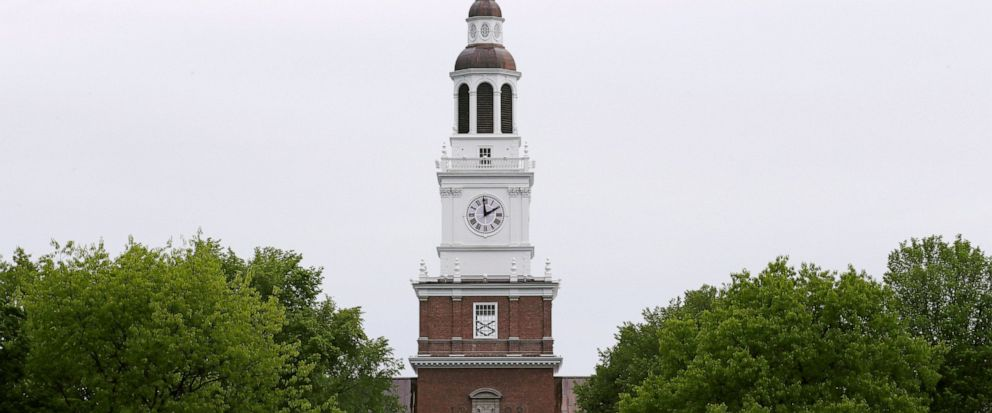 FILE - In this May 22, 2018 file photo, the spire of the Baker-Berry Library stands above The Green at Dartmouth College in Hanover, N.H. The school announced Tuesday, Aug. 13, 2019, its new unified policy on sexual misconduct for faculty, students a