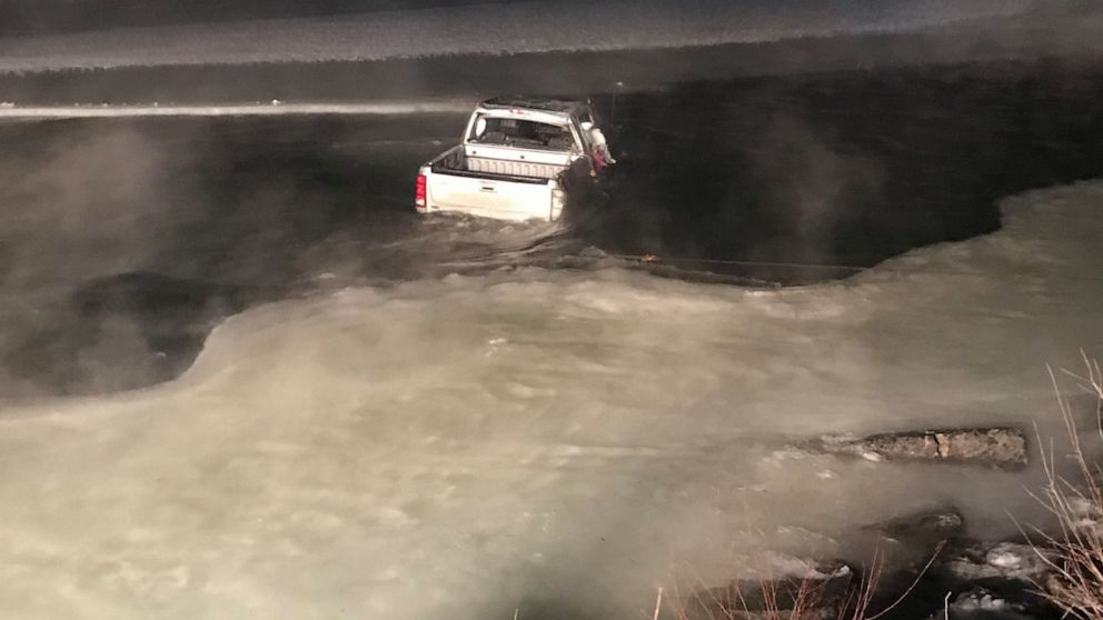Man, 2 dogs rescued from truck partially submerged in icy river