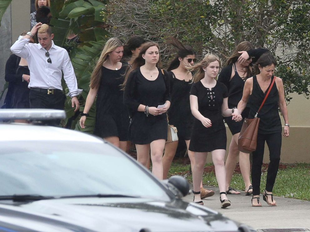 PHOTO: Mourners depart the Church by the Glades in Coral Springs, Fla., after the funeral for football coach Aaron Feis, who was killed in the mass shooting at Marjory Stoneman Douglas High School.
