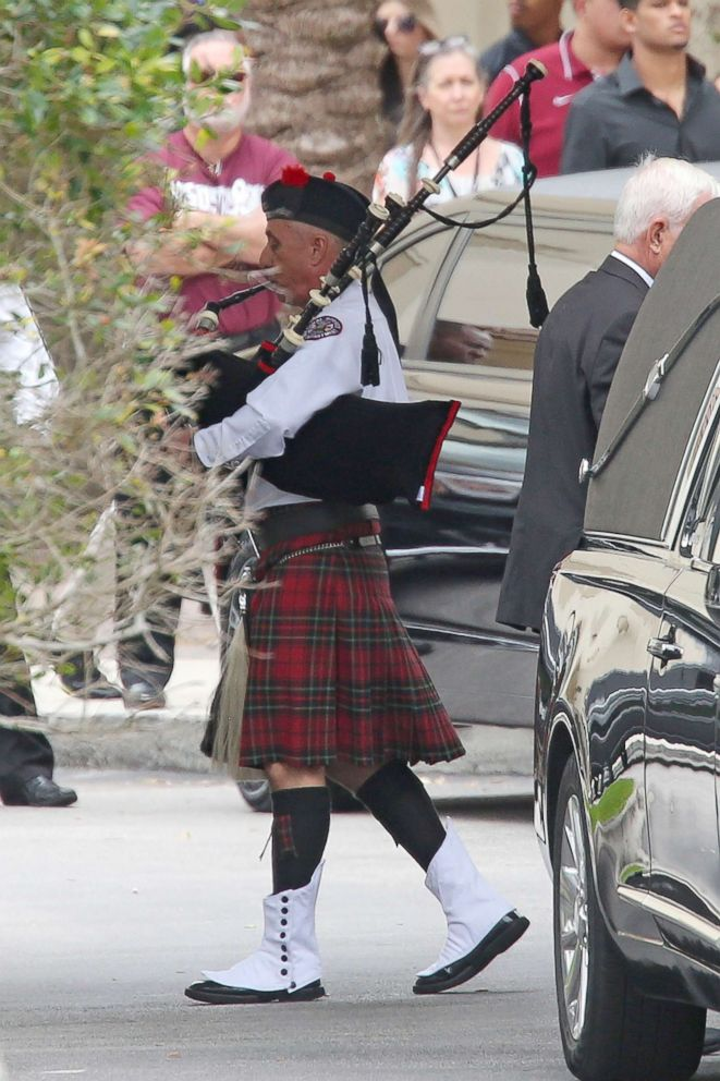 PHOTO: A bagpiper leads the casket carrying the body of Aaron Feis, who was killed at Marjory Stoneman Douglas High School, at the Church by the Glades, Feb. 22, 2018, in Coral Springs, Fla.