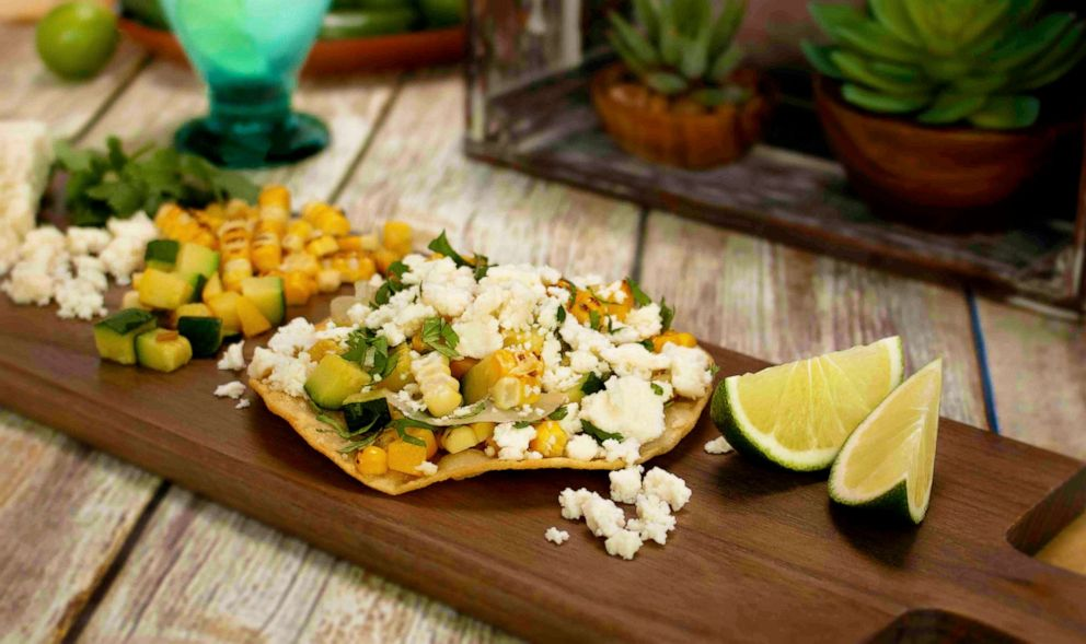 PHOTO: Aaron Sanchezs summer squash tostadas with rajas, roasted corn, crema mexicana and queso fresco.