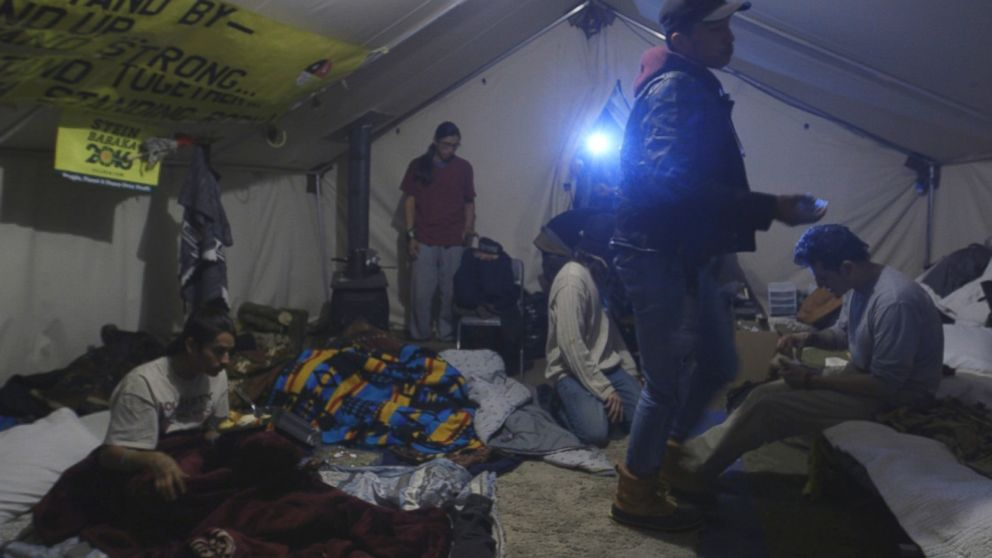 The International Indigenous Youth Council inside their tent at Rosebud Camp.
