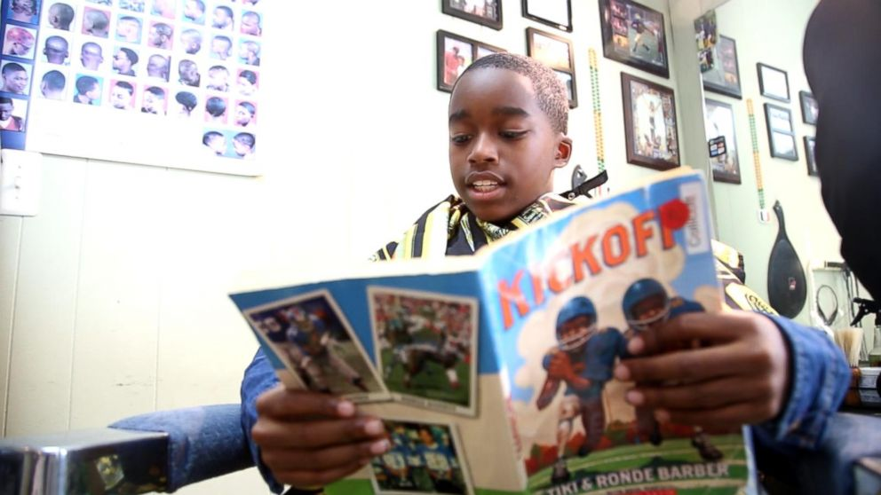 Children get $2 off their haircut for reading to the barbers at Fuller Cut.