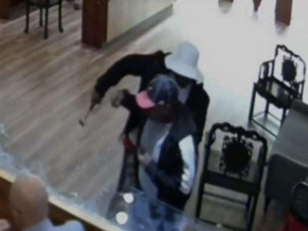 One man bashed display cases with a hammer, while the other made off with $2 million in jewelry from a Houston-area store on Jan. 10, 2018.