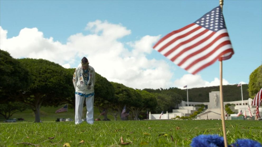 Pearl Harbor survivor Stuart Hedley visits the burial site of those killed during the 1941 attack.
