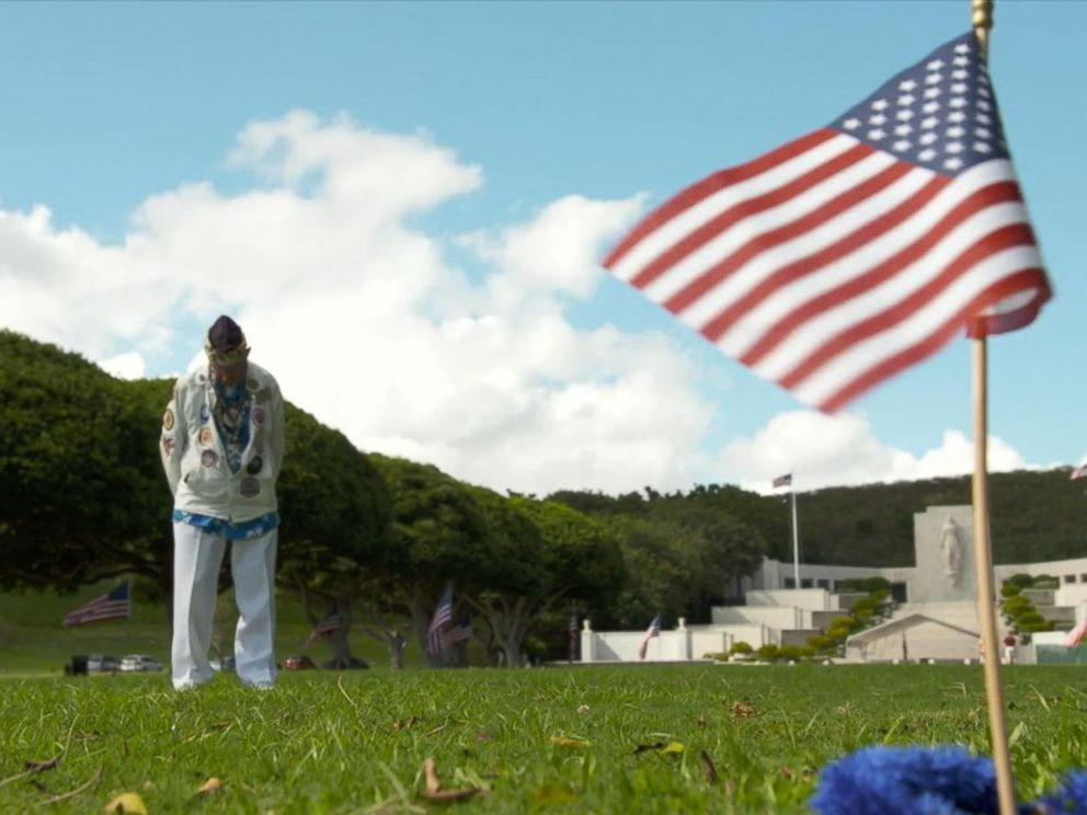 PHOTO: Pearl Harbor survivor Stuart Hedley visits the burial site of those killed during the 1941 attack.