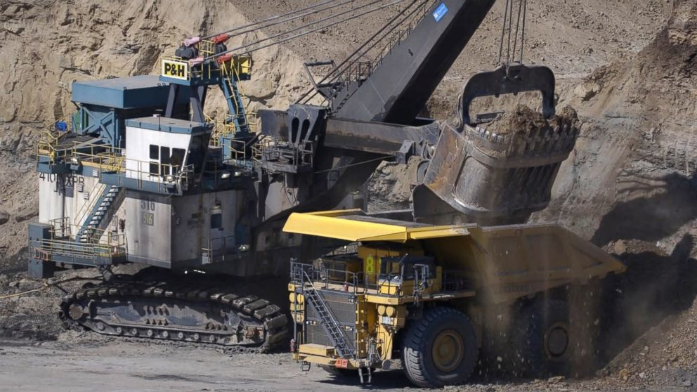 In surface mining, trucks haul dirt and stones, called overburden, from one part to another as other haul trucks move the coal found directly below.