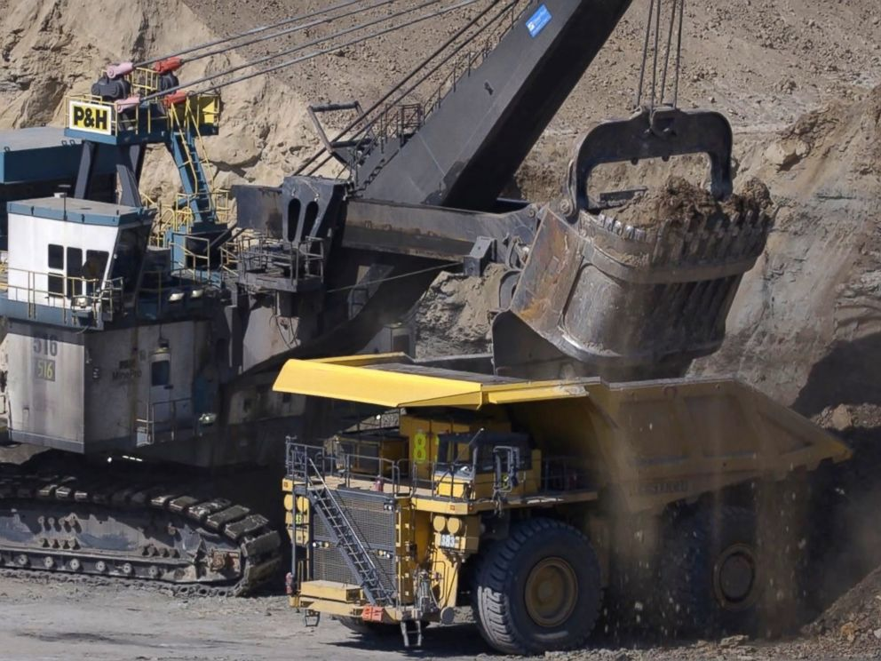 PHOTO: In surface mining, trucks haul dirt and stones, called overburden, from one part to another as other haul trucks move the coal found directly below.
