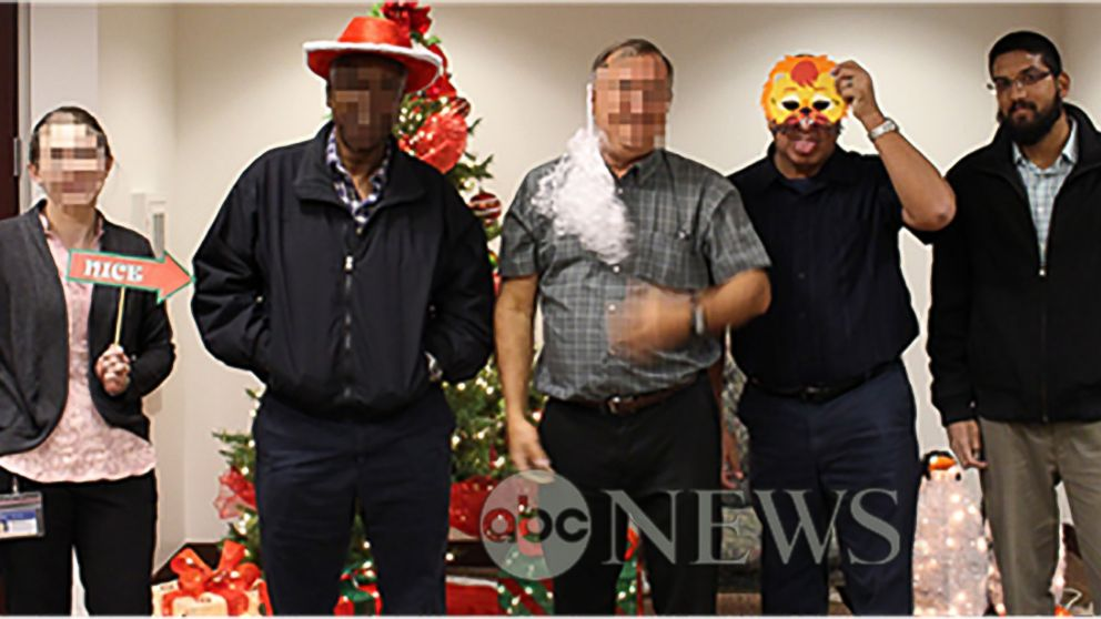 In a photo obtained by ABC News, Syed Farook is seen posing with his coworkers in front of a Christmas tree inside the Inland Regional Center shortly before launching into a rampage that left 14 people dead on December 2, 2015.