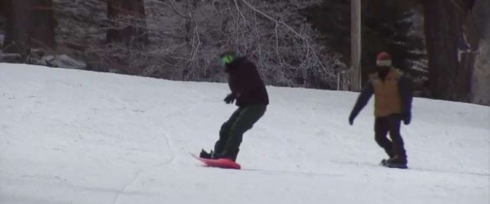 Snowboarders hit the slopes in Wrightwood, California, on Tuesday after new snow fell.