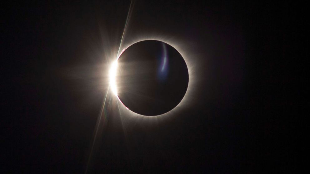 """The """"diamond ring"""" effect is visible as the Earth's moon passes in front of the sun during a solar eclipse viewed from Madras, Ore., Aug. 21, 2017."""