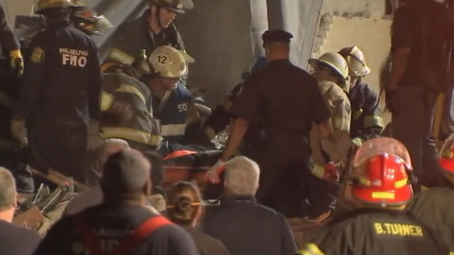 PHOTO:A 14th survivor was pulled from the rubble of a collapsed building in Philadelphia late Thursday night, June 5, 2013. The woman, identified as Myra Plekam, was rushed to the hospital minutes after officials raised the death toll to six people.