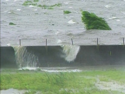 Picture of water topping over levee.