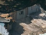 PHOTO: An aerial view above the Bush house in Seffner, Fla, March 3, 3013, reveals the large sinkhole that pulled Jeff Bush, 37, into the abyss while sleeping, Feb. 28, 2013.  Authorities stopped all recovery efforts on March 2, 2013, when the site became