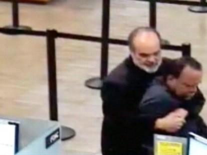 VIDEO: California professor Kim Komenich restrains a bank robber with a bear hug.