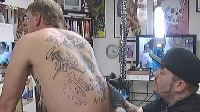 VIDEO: Man honors 29 deaths in West Virginia mine explosion with tattoos.
