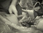 PHOTO: Baby Nevaeh Atkins holds Dr. Allan Sawyers hand from inside her mothers womb.