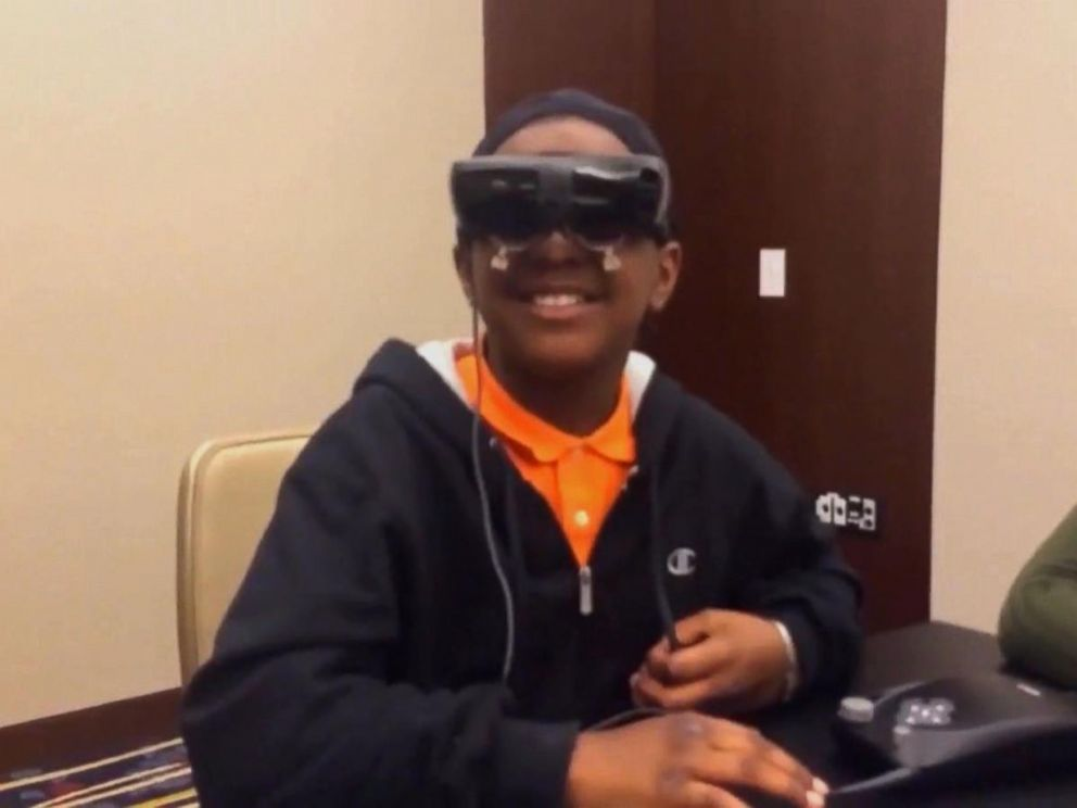 PHOTO: Virginia fifth-grader Chris Ward is legally blind but he recently got to see his mother Marquita Hackley for the first time while trying on new electronic glasses called eSight .