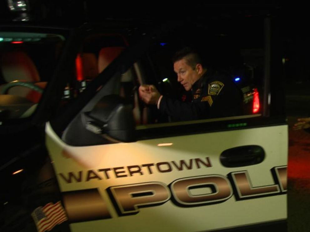 PHOTO: Watertown police officer John MacLellan reenacts part of his shootout with the Boston Marathon bombers, three days after the blasts in 2013.
