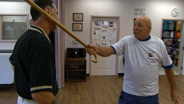PHOTO: Edward Pacetti, 72, right, demonstrates his cane fu skills on Cane Masters instructor Merle McAlpin.