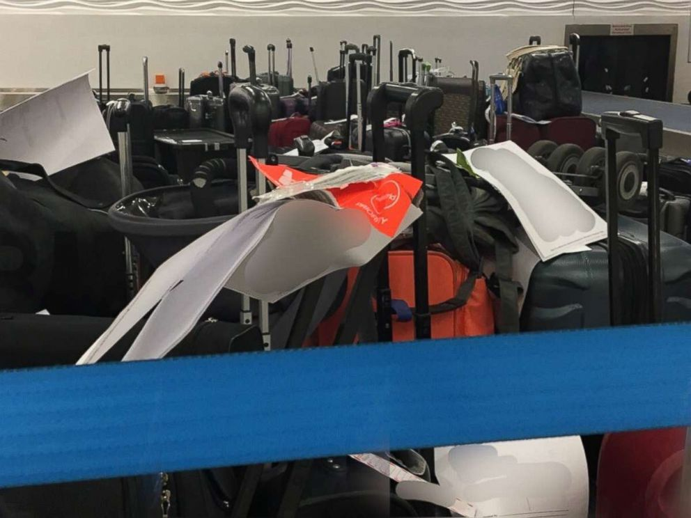 Bags piled up at the Charlotte Douglas International Airport in Charlotte, North Carolina, after hundreds of flights were canceled.