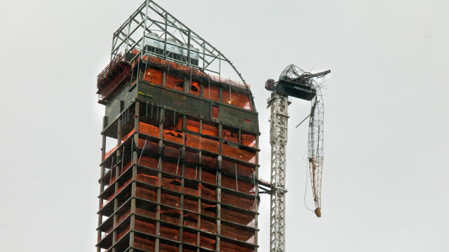 PHOTO: A construction crane dangles off of a skyscraper in midtown New York, Oct. 29, 2012.