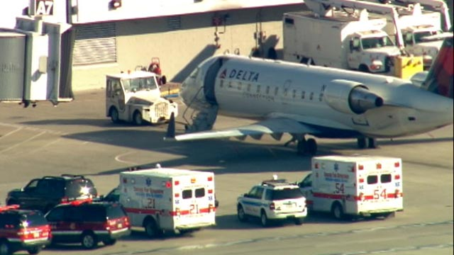 PHOTO: A Delta flight was under quarantine at Chicago Midway Airport, April 26, 2012. Police and paramedics surrounded the plane on the tarmac.