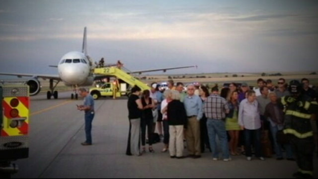 "PHOTO: Officials say one person was taken into custody following a ""possible security threat"" on a Denver-bound flight on Friday, June 14, 2013."