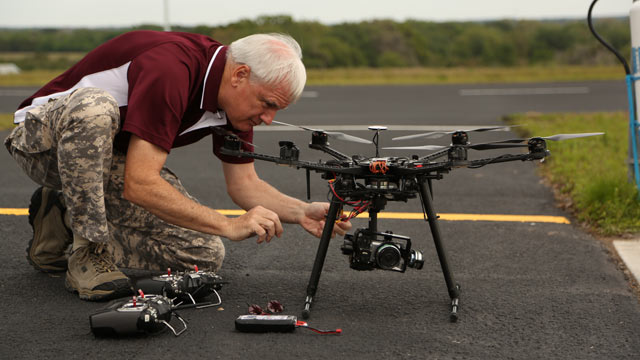 PHOTO: Gene Payson, an instructor at the new Unmanned Vehicles University in Sarasota, Fla., tinkers with a drone. The program is the only institution in the United States to offer post-graduate engineering degrees in unmanned aerial vehicle systems.
