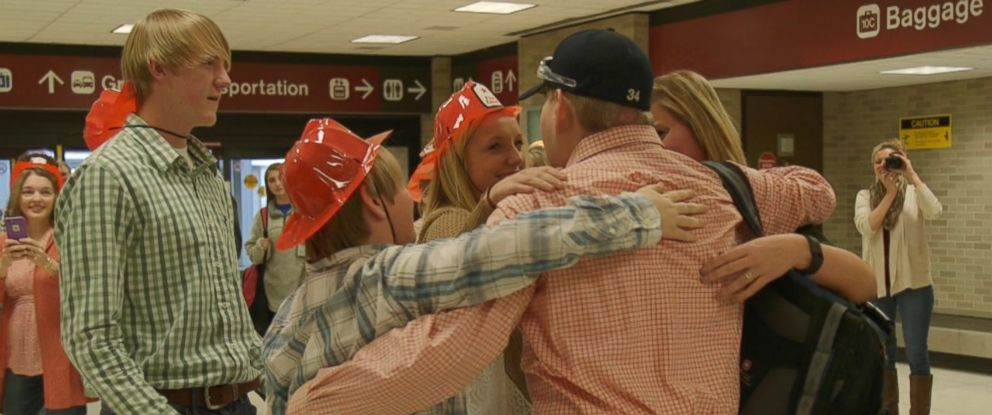 Face transplant recipient Pat Hardison receives a warm welcome from his children after returning home to Mississippi.