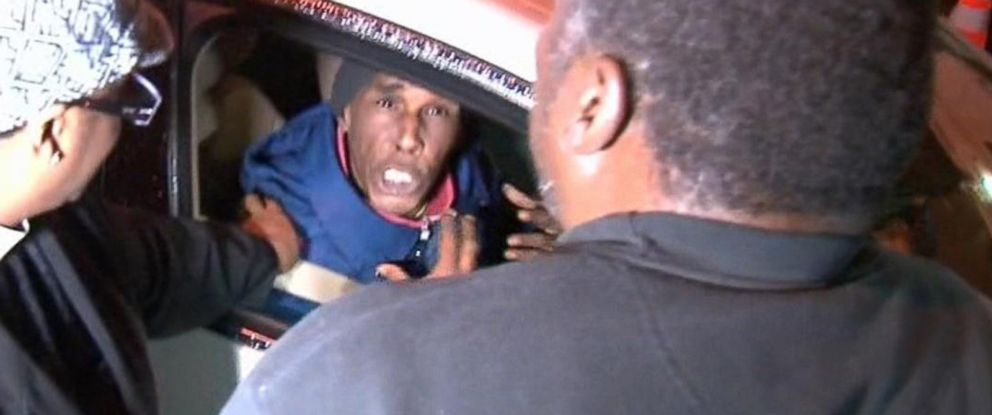 Benjamin Carr, father of Eric Garner, who was killed by a police officer who put him in a chokehold, tries to calm down an angry driver, Dec. 3, 2014, in Staten Island, New York.