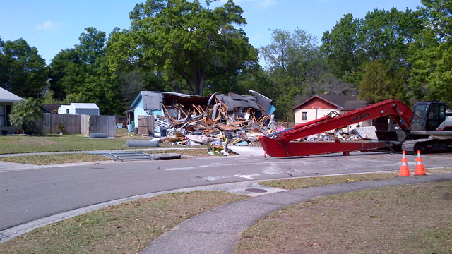 PHOTO: Crews demolished a Florida home over a massive sinkhole, where one man was swallowed by the earth.