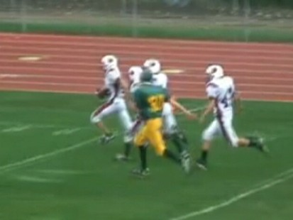VIDEO: A teen with Down Syndrome scores a touchdown during a high school game.