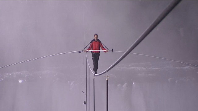 PHOTO: Daredevil Nik Wallenda became the first person to walk across Niagara Falls on a high wire on June 15, 2012.