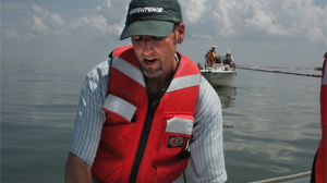 PHOTO Greenpeace marine biologist John Hocevar points on the map where damage has been done by the oil spill.