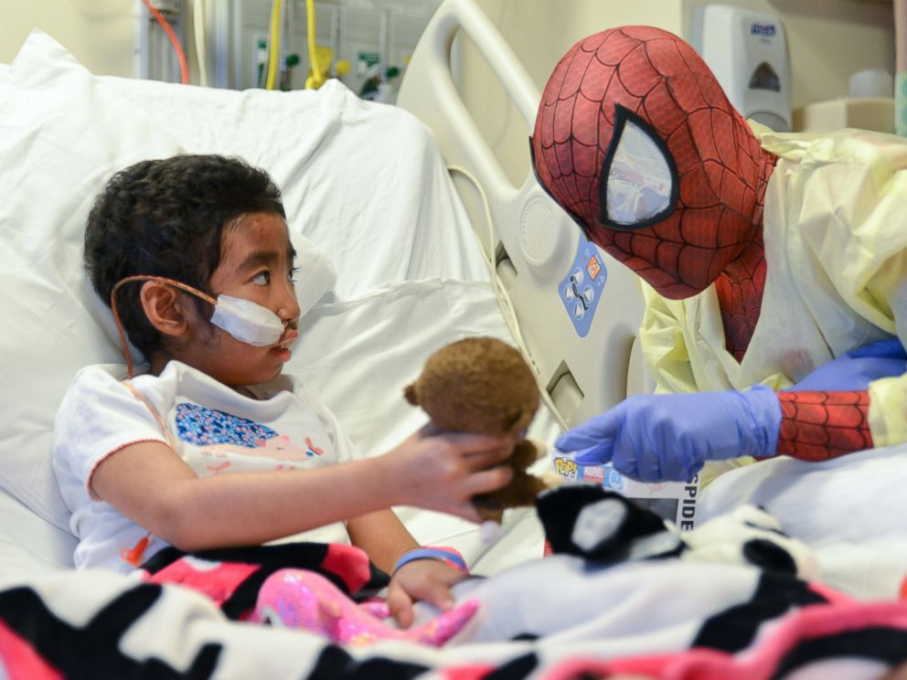PHOTO: Christina, 8, shows Spiderman her favorite stuffed monkey, Coconut and later her stuffed panda, Bamboo.