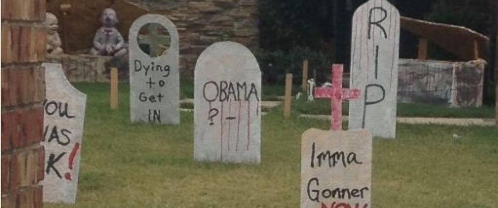 """PHOTO: A woman is upset with her neighbors in Edmond, Okla. for putting a tombstone decoration out that reads """"Obama"""" on the front of it."""