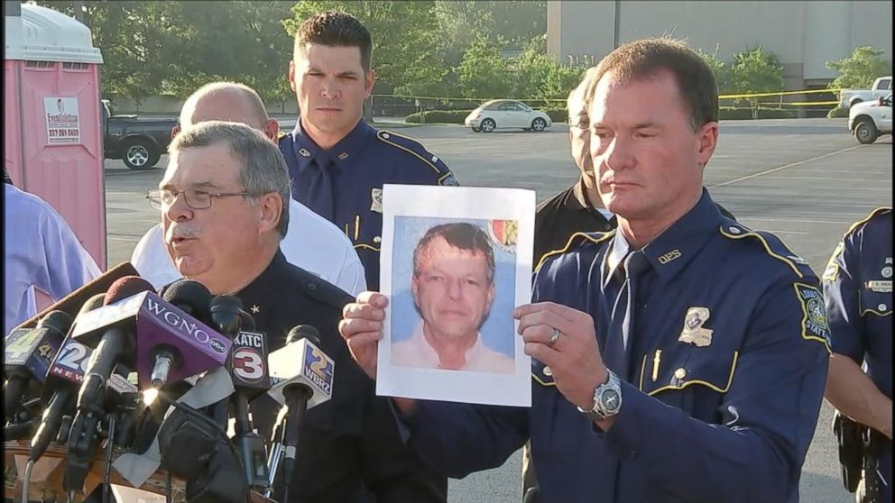 A photo of John Houser, who shot several people in a Lafayette movie theater on July 23, 2015, is shown during a press conference, July 24, 2015.