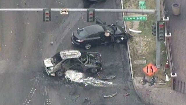 PHOTO: A gunfight between a Maserati and an SUV on the Las Vegas Strip caused a fiery crash at an intersection involving a taxi that burst into flames, leaving three people dead and at least three injured, Feb. 21, 2013 police said.